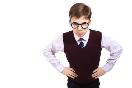 Portrait of a serious schoolboy in a  glasses. Isolated over white background. photo