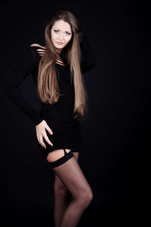 Fashion photo, beautiful sexy  model is posing over black background photo