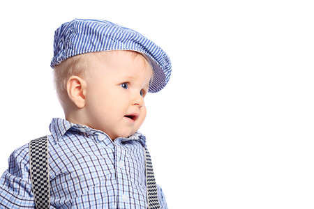 fashion boy: Beautiful little boy. Shot in a studio. Isolated over white background.