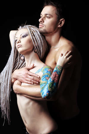 Shot of a passionate loving couple. Over black background. Stock Photo - 8835042