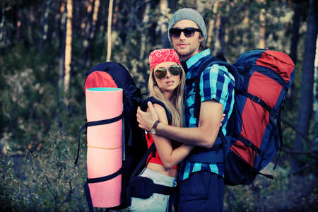 Couple of tourists making their journey at the mountains. photo