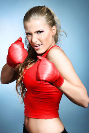 agressive: Shot of a sporty young woman. Active lifestyle, wellness, sport. Stock Photo