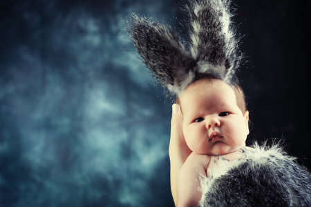 Portrait of a beautiful baby in rabbit costume. photo