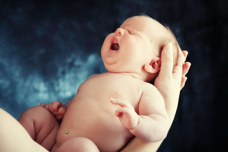 new born baby: Portrait of a beautiful baby. Stock Photo