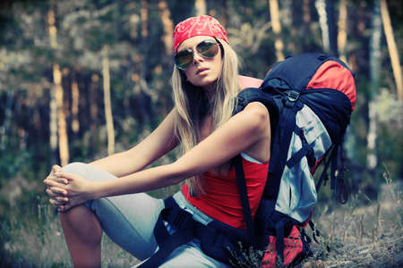 Young woman tourist posing at the mountains. photo
