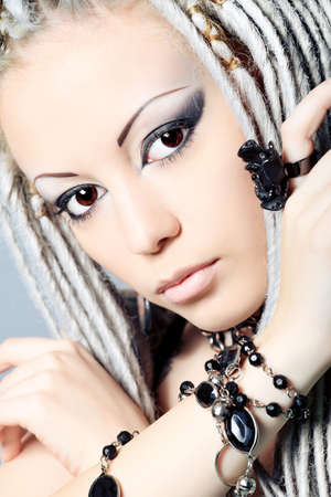 Portrait of a stylish young woman with white dreadlocks. Fashion. photo
