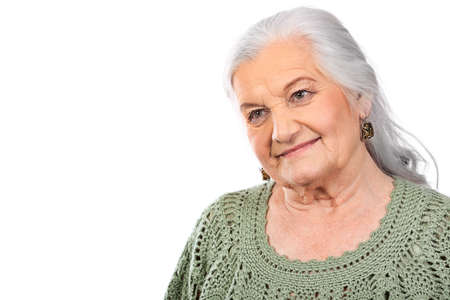 Portrait of a smiling senior woman. Isolated over white background. photo