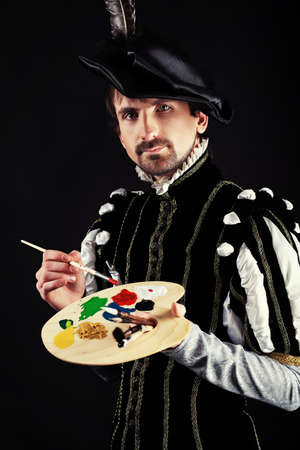 16th: Portrait of a handsome man artist in 16th century costume. Shot in a studio. Stock Photo