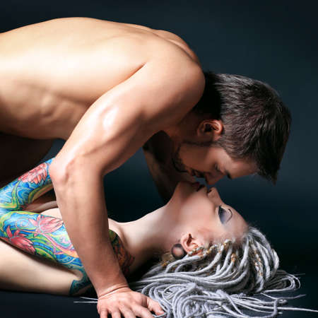 Shot of a passionate loving couple. Over black background. Stock Photo - 8835209