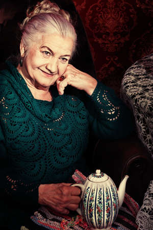 Portrait of a smiling senior woman having a rest at home.  photo
