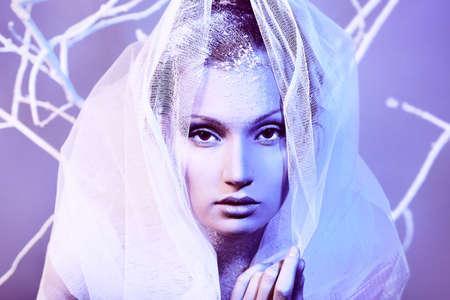 Art portrait of a beautiful woman in veil. Fashion, beauty. photo