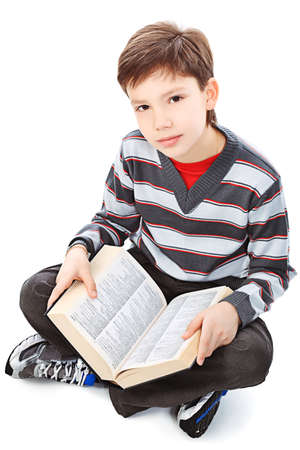 dictionaries: Educational theme: portrait of a schoolboy with books. Isolated over white background.
