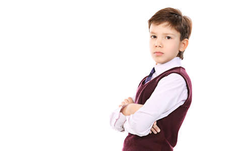 Educational theme: portrait of a schoolboy. Isolated over white background. photo