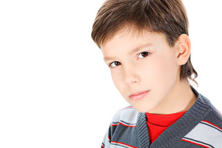 Portrait of a 9 year boy. Isolated over white background. photo