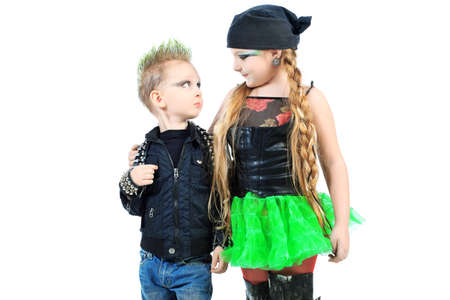 Shot of little boy and girl singing rock music in studio. Isolated over white background. photo
