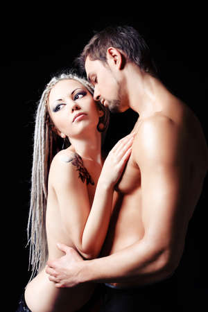 Shot of a passionate loving couple. Over black background. Stock Photo - 8851326