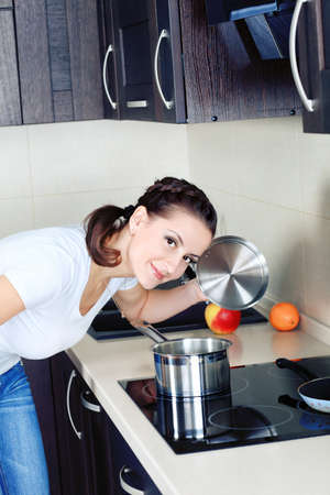 Woman is cooking on a kitchen at home. photo