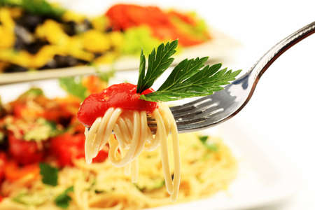 Food theme: pasta dish with shrimps and vegetables. photo