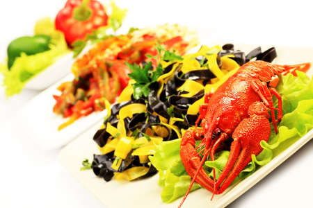 Food theme: tasty colorful pasta dish with boiled lobsters. photo