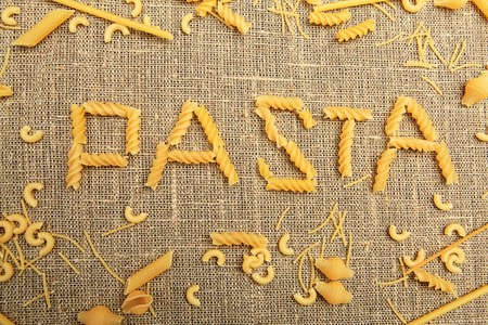 Food theme: conceptual background of uncooked pasta. photo