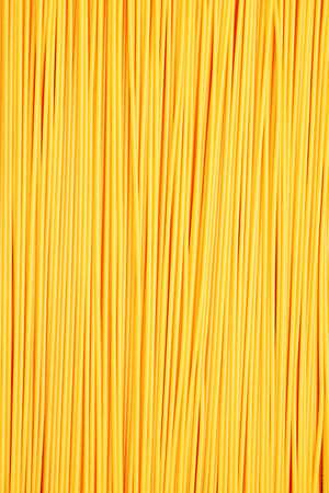 Food theme: uncooked pasta background. Stock Photo