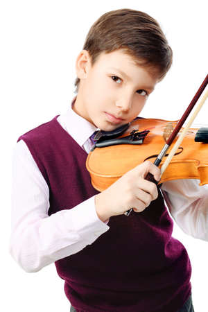 Portrait of a boy playing his violin. Isolated over white background. photo