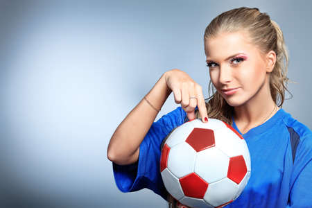 Shot of a sporty young woman with a ball. Active lifestyle, wellness. photo
