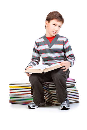 achiever: Educational theme: portrait of a schoolboy with books. Isolated over white background.