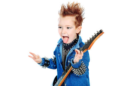 Shot of a little boy playing rock music with electric guitar. Isolated over white background. Stock Photo - 8935195