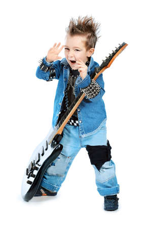 Shot of a little boy playing rock music with electric guitar. Isolated over white background. photo