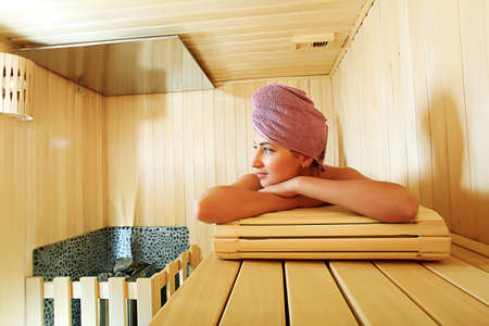 Beautiful young woman relaxing in the sauna. Beauty, healthcare. photo