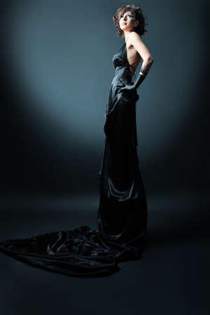 Beautiful fashionable woman in black dress. Studio shot. Stock Photo - 8938333