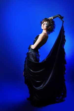 Beautiful fashionable woman in black dress. Studio shot. photo
