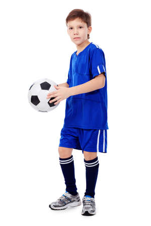 soccer uniforms: Portrait of a boy with a ball. Isolated over white background. Stock Photo