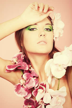 Portrait of a beautiful tanned woman in bikini posing with flowers. Stock Photo - 9006312