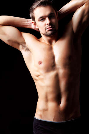 Portrait of a handsome muscular young man. Shot in a studio. Stock Photo - 9007251