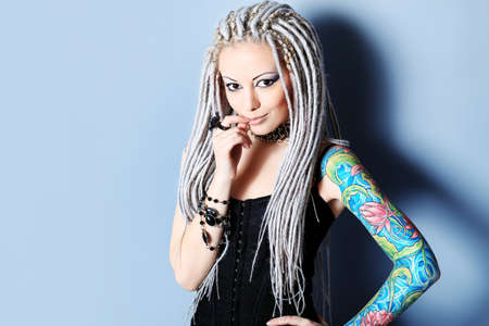 fascinating: Portrait of a stylish young woman with white dreadlocks. Fashion.