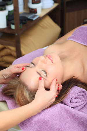 Beautiful young woman on a massage at a salon. Beauty, healthcare. Stock Photo - 9007160