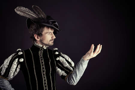 16th: Portrait of a handsome man grandee in 16th century costume. Shot in a studio. Stock Photo