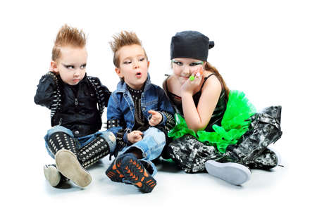 hardrock: Group of children singing in heavy metal style. Shot in a studio. Isolated over white background. Stock Photo
