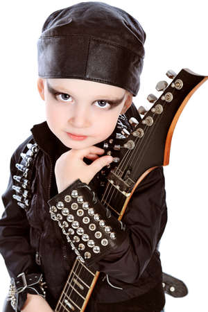 Shot of a little boy playing rock music with electric guitar. Isolated over white background. Stock Photo - 9073914