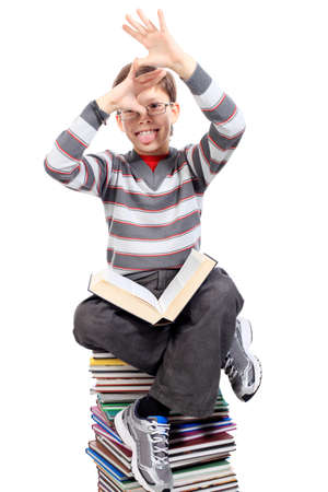 Educational theme: portrait of a shouting schoolboy with books. Isolated over white background. photo