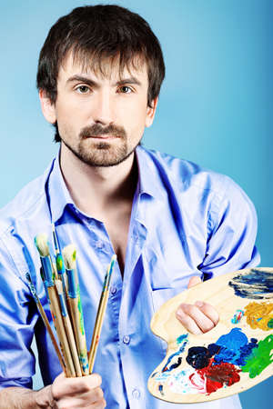 Portrait of an artist painting on easel. Shot in a studio. Stock Photo - 9140563