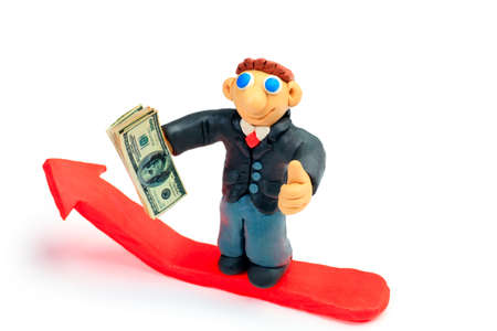 Shot of a plasticine businessman in a suit holding money. Isolated over white background. Stock Photo - 9140613