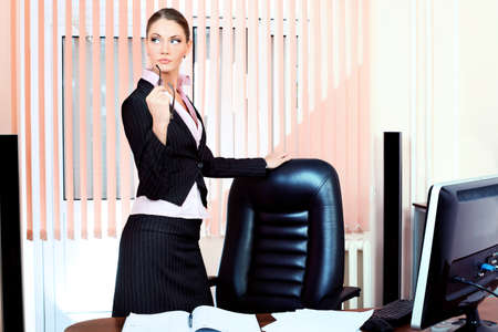 Beautiful business woman is working at the office. Stock Photo - 9184199