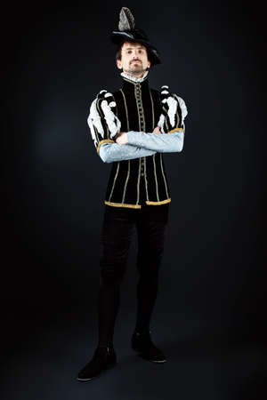 costume ball: Portrait of a handsome man grandee in 16th century costume. Shot in a studio. Stock Photo