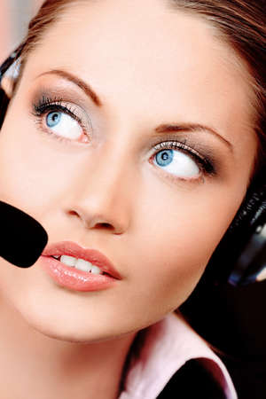 Beautiful customer service operator woman with headset photo