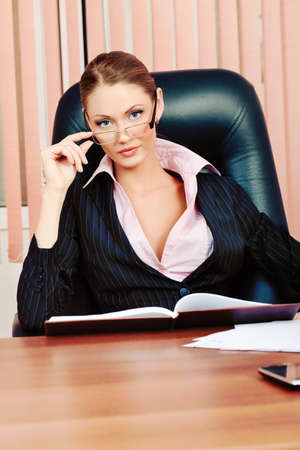 Beautiful business woman is working at the office. photo