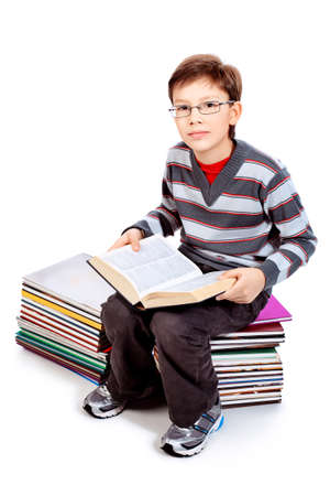 Educational theme: portrait of a schoolboy with books. Isolated over white background. photo