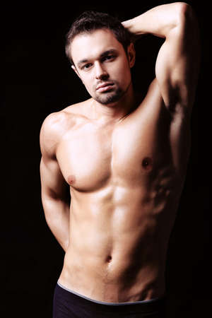 skivvy: Portrait of a handsome muscular young man. Shot in a studio. Stock Photo